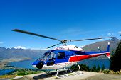 Helicopter on top of  Bob's Peak with the view on Lake Wakatipu in Queenstown, New Zealand