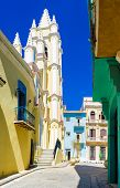 Colorful street in Old Havana with the Church of the Angel, a historical and religious landmark, on  poster