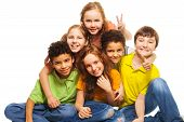 stock photo of exciting  - Group of happy 10 years old boys and girls smiling gesticulating and hugging - JPG