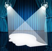stock photo of aspergers  - Spotlight on the brain with lights shinning a human head shaped profile on a stage with blue velvet curtains as a mental health concept for cognitive disorders as autism or Asperger - JPG