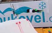 BUKOVEL, UKRAINE - FEBRUARY 23: Lloyd Wallace, Great Britain performs aerial skiing during Freestyle