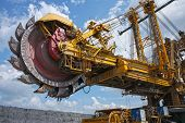 stock photo of open-pit mine  - huge mine excavator for brown coal under sky - JPG