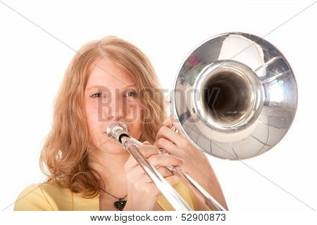Closeup Of Young Woman In Yellow With Trombone