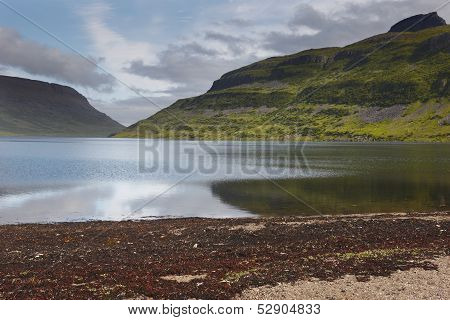 Iceland. Isafjardaraiup Fiord. Landscape With Mountains And Lake.