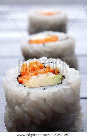 Vertical Macro Of 3 Rolls Of Sushi