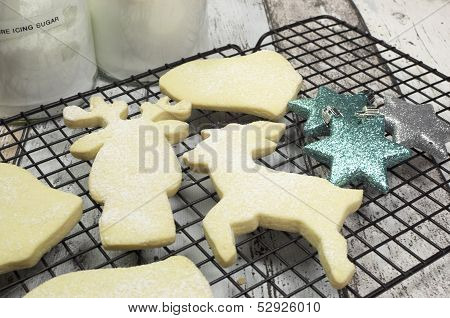 Baking Homemade Christmas Shortbread Cookie Biscuits In Reindeer, Bells, Santa Boot, And Tree Shapes