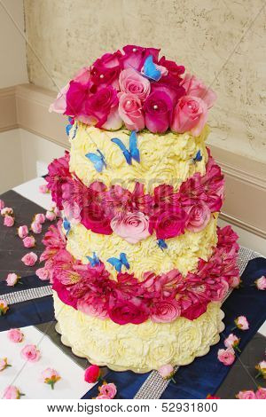 White and red cake with roses and butterflies