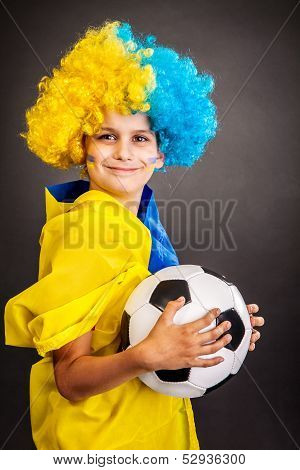 Football Fan With  Ukrainian Flag On A Black Background