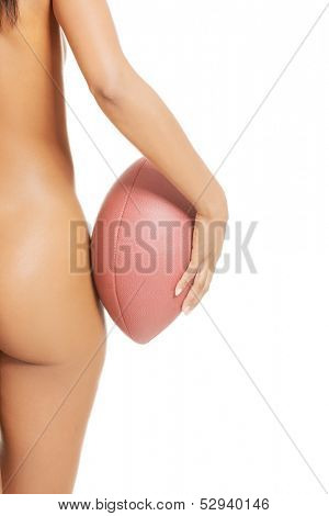 Female sexy right buttock. Close up. She's holding a ball.  isolated on white.