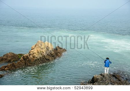 A man fishing at the sea