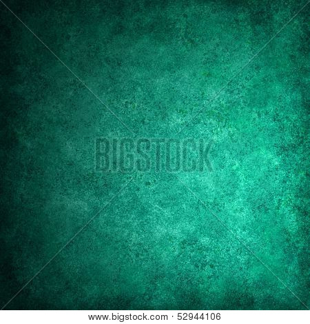 green background or green paper with bright spotlight on black background texture