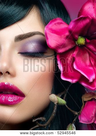 Perfect Makeup. Holiday Make up. Beauty Brunette Model Girl Closeup Portrait. Perfect Skin. Smoky Eyes and Purple Glossy Lips. Long False Eyelashes