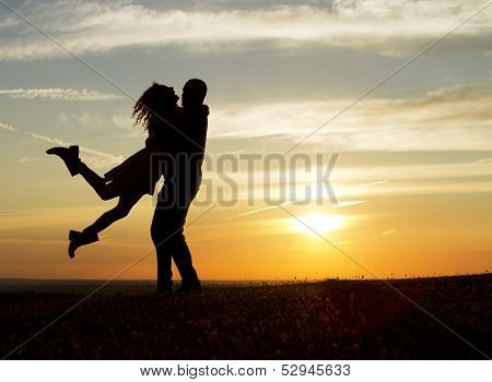 Young couple having fun at sunset