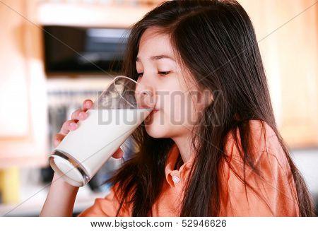 Beautiful Young Biracial Girl Drinking Milk