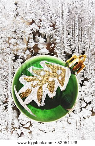 Christmas Tree Toy On The Background Of Frost Patterns.