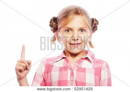 Pretty school girl pointing her index finger upwards in excitement.