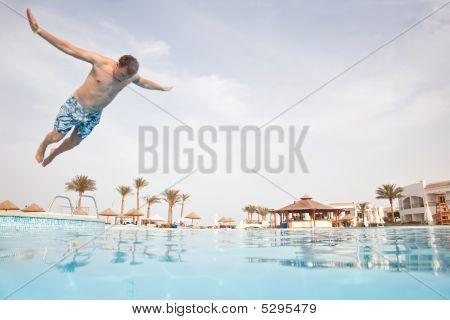 Man Having Fun At Swimming Pool.