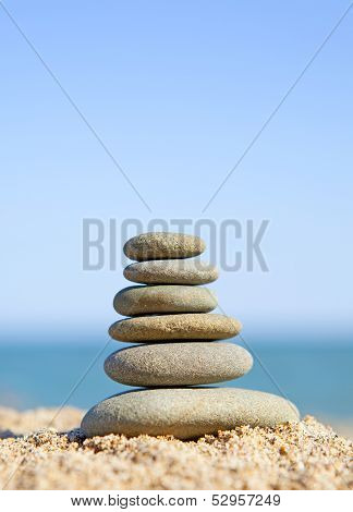 Stack Of Zen Stones Near The Ocean