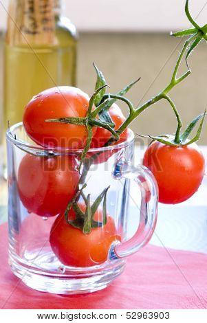 red tomatos in mug