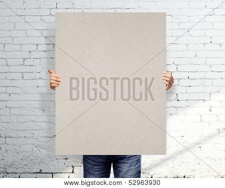 Men Holding Poster