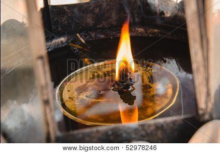 Flames Burn In Oil