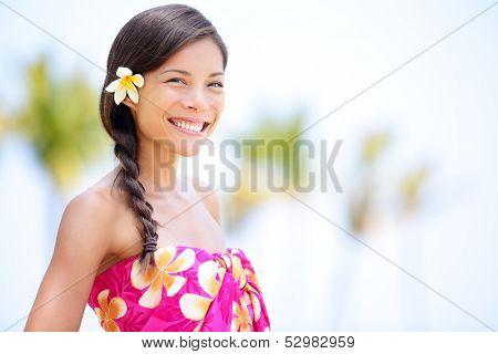 Beach woman smiling happy in sarong - in joyful bliss on travel vacation. Pretty mixed race Asian Caucasian woman on Hawaiian beach resort. Hawaii, USA.