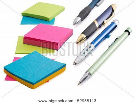 School and Office Supplies, Pens and Paper, Isolated on a White Background