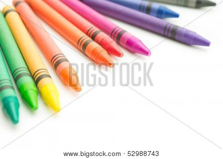 Crayons of beautiful color spectrum isolated on white.