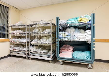 Large group of hospital supplies arranged in trolleys
