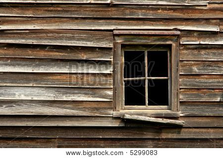 Broken Window On An Old Abandoned Wood House