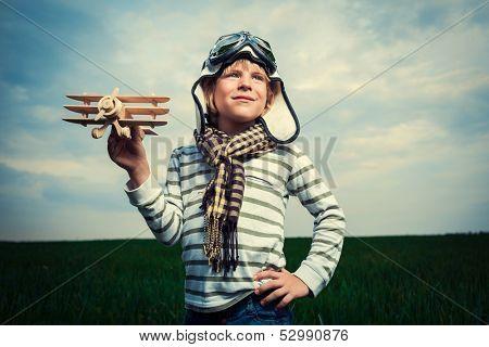 Little boy with toy in field