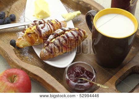 Breakfast with croissants and milk