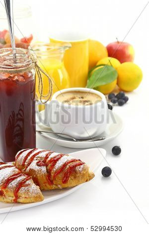 Breakfast with croissants and beverages