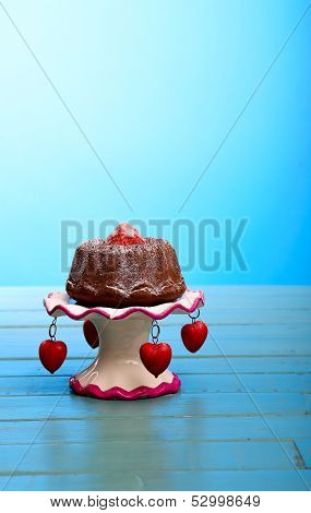 Chocolate Mini Pound (bundt) Cake With Strawberry And Icing Sugar On Stand With Hearts