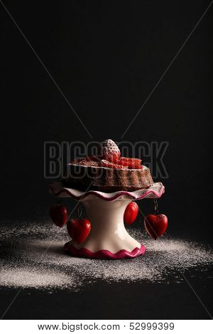 Chocolate Sponge Cake With Strawberry And Icing Sugar On Stand With Hearts