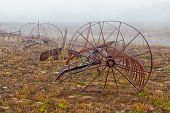 pic of horse plowing  - Rusting Old Horse Drawn Tiller Plow in the Morning Fog - JPG