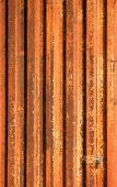 stock photo of hematite  - A corrugated metal sheet that has been severely damaged by rust - JPG