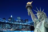 stock photo of bridge  - Brooklyn Bridge and The Statue of Liberty at Night - JPG
