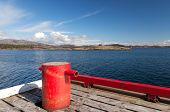foto of bollard  - Red mooring bollard on wooden pier in Norway - JPG