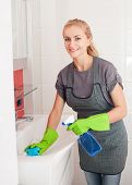 Woman washing sink. Female cleaning at home