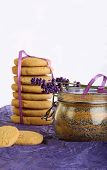 Lavender Cookies With Sugar And Flowers On Purple Paper