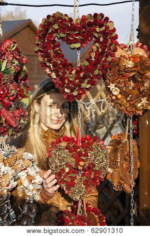 portrait of woman at Christmas market, Vienna, Austria