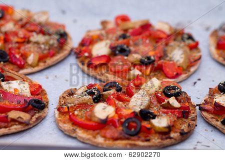 Home Baked Vegan Mini Pizza On Parchment Paper