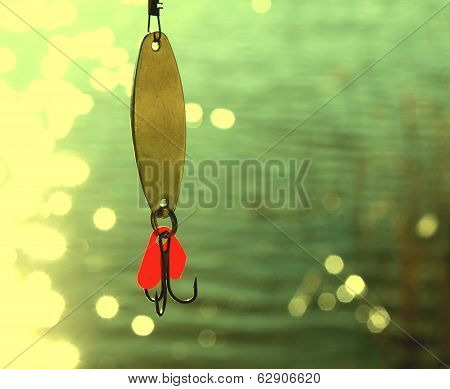fishing lures over water with beautiful bokeh
