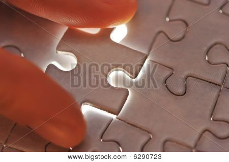 Hand Placing Missing Puzzle Piece