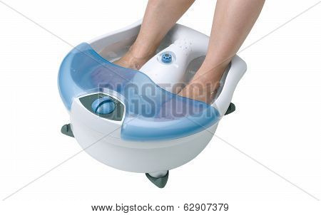 Woman's feet in a vibrating feet massager