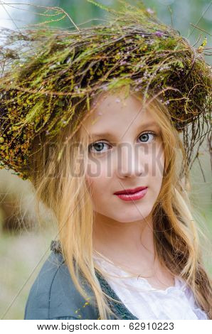 Close Up Portrait Of A Girl In A Folk  Medieval Style With A Circlet Of Flowers