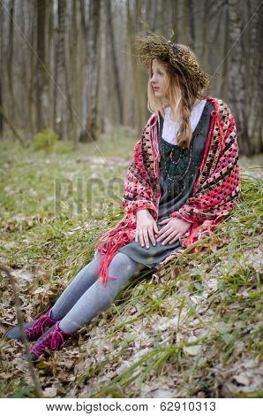 Folk Style Picture Of A Girl In A Circlet Of Flowers Sitting In The Forest