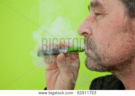 Man Puffing On An E-cigarette