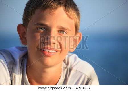 Smiling Teenager Boy Against Sea
